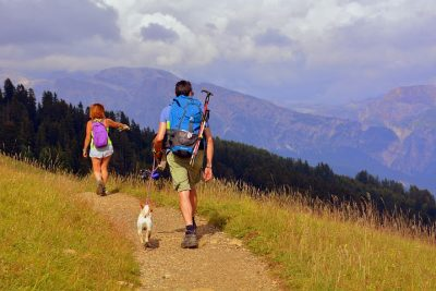 Couple Hiking With Dog